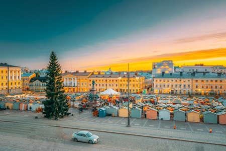 Helsinki, Finland. Christmas Xmas Market With Christmas Tree On Senate Square In Sunset Sunrise