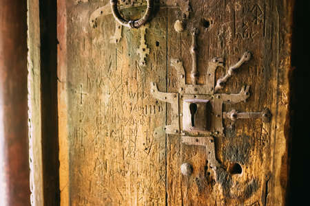 Borgund, Norway. Carved Details Of Famous Wooden Norwegian Landmark Stavkirke. Ancient Old Wooden Triple Nave Stave Church. Close View, Door Details Stock Photo