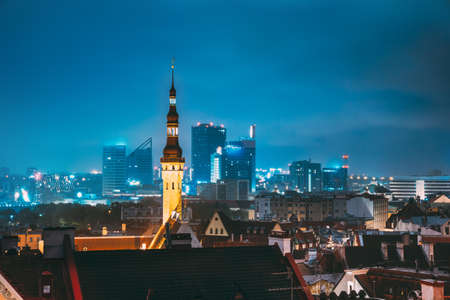 Tallinn, Estonia. Tower Of Town Hall On Background With Modern Urban Skyscrapers. City Centre Architecture 스톡 콘텐츠