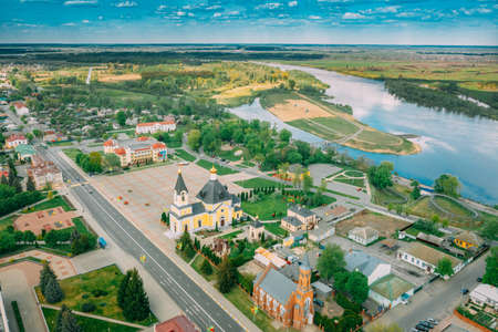 Rechytsa, Belarus. Aerial View Of Residential Houses, River Dnieper And Holy Assumption Cathedral In Sunny Summer Day. Top View. Drone View. Birds Eye View