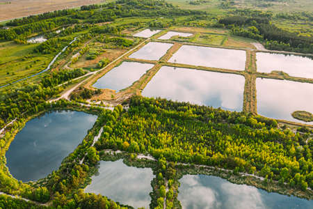 Aerial View Retention Basins, Wet Pond, Wet Detention Basin Or Stormwater Management Pond, Is An Artificial Pond With Vegetation Around The Perimeter, And Includes A Permanent Pool Of Water In Its Design.