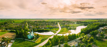 Krupets, Dobrush District, Gomel Region, Belarus. Aerial View Of Old Wooden Orthodox Church Of The Holy Trinity At Sunny Autumn Day 版權商用圖片