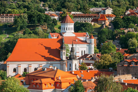 Vilnius, Lithuania. View Of Cathedral Of Theotokos And Church Of St. Johns, St. John Baptist And St. John Apostle And Evangelist In Summer Day