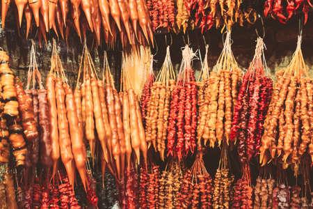 Colorful Churchkhela Hanging In Shop. Churchkhela Is A Traditional Georgian Food Sausage-shaped Candy 版權商用圖片