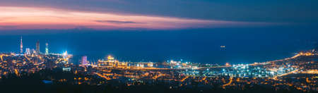 Batumi, Adjara, Georgia. Panorama, Aerial View Of Urban Cityscape At Sunset. Town At Evening Blue Hour time. City And Port In Night Lights Illuminations. 版權商用圖片