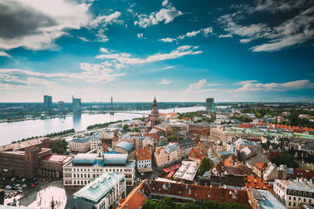 Riga, Latvia. Riga Cityscape Slyline In Sunny Summer Day. Famous Landmarks - Riga Dome Cathedral And St. Jamess Cathedral, or the Cathedral Basilica of St. James.