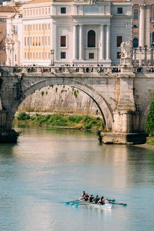 Rome, Italy. Group Of People Training On Kayak. Sightseeing Boat Floating Near Aelian Bridge. Tour Touristic Boat