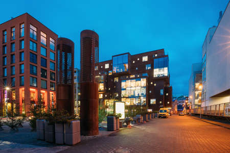 Tallinn, Estonia. View Of Historical Rotermann City With Fir Tree In Evening Illuminations. Rotermann Quarter Includes Old Industrial Buildings With New Function And Modern Architecture