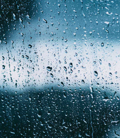 Drops Of Water Or Rain On Wet Glass Background. Moody Photo In Cold Blue Color 版權商用圖片