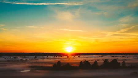 Beautiful Forest On Sunrise. Morning Fog On Meadow 版權商用圖片