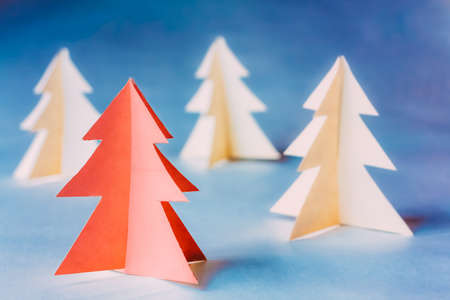 Eco Concept Christmas Trees Made Of Paper. Christmas Card. Simple Minimalistic Paper Decoration. One Of The Pine Trees Painted In Living Coral Color. Living Coral Colour Is Colour Trend Of 2019 Year 版權商用圖片