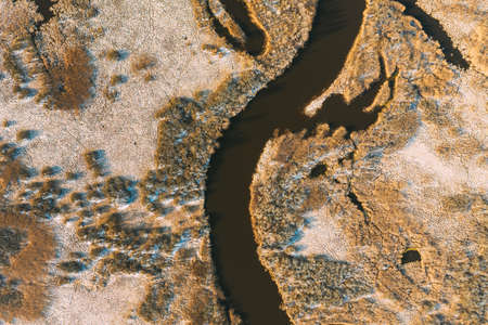 Belarus. Aerial View Of Dry Grass And Curved River Landscape In Early Spring Day. High Attitude View. Marsh Bog. Drone View. Birds Eye View
