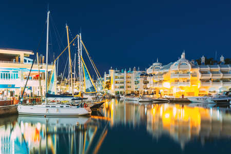 Benalmadena, Spain. Night Scenery View Of Floating Houses, Vessel In Puerto Marina. Malaga Region, On The Costa Del Sol. It Caters For A Large Number Of Tourists