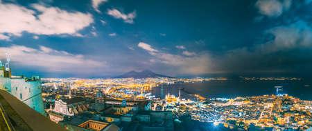 Naples, Italy. Skyline Cityscape In Evening Lighting. Tyrrhenian Sea And Landscape With Volcano Mount Vesuvius. City In Night Illuminations