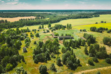 Belarus. Aerial View Of Cowshed In Chernobyl Zone. Chornobyl Catastrophe Disasters. Dilapidated House In Belarusian Village. Whole Villages Must Be Disposed. Chernobyl Resettlement Zone