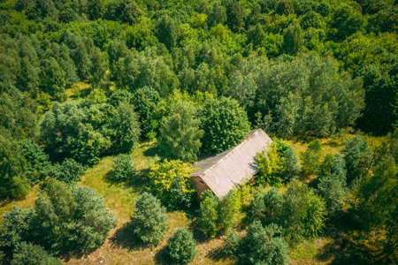 Belarus. Aerial View Of Ruined Cowshed In Chernobyl Zone. Chornobyl Catastrophe Disasters. Dilapidated House In Belarusian Village. Whole Villages Must Be Disposed. Chernobyl Resettlement Zone