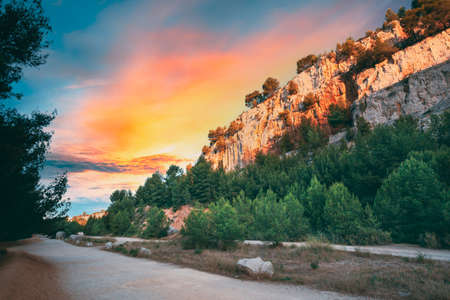 Cassis, Calanques, France. French Riviera. Beautiful Nature Of Cote De Azur On The Azure Coast Of France. Calanques - A Deep Bay Surrounded By High Cliffs. Altered Sunset Sky. Road To Bay