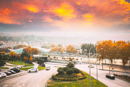 Tbilisi, Georgia. View On Noe Jordania Bank in Sunset Time. City Traffic On Streets. Autumn Evening