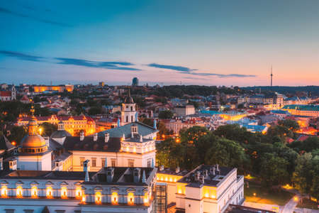 Vilnius, Lithuania, Eastern Europe. Aerial View Of Historic Center Cityscape In Blue Hour After Sunset. Old Town In Night Illuminations.