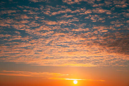 Sunset Cloudy Sky With Clouds. Sunset Sky Natural Background. Dramatic Sky. Sunset In Yellow, Orange, Pink Colors
