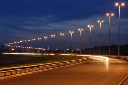 Electric on night road, illumination on the highway, horizontal