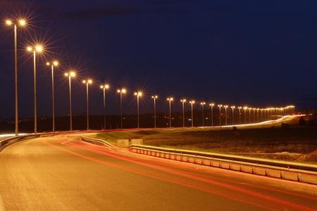 Lighting the night highway, road lighting masts, night view, horizontal photo