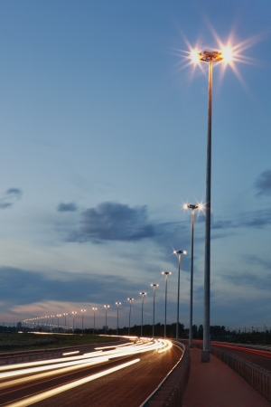 Lighting columns on the highway, night lighting road, track at night lights, vertical photo  photo