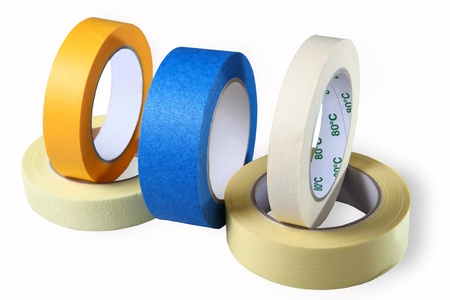 masking tape: Adhesive tape on paper, blue, yellow and brown, horizontal, image, isolated, on a white background. Stock Photo