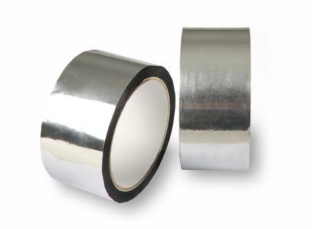 the padding: Tape for padding, insulation, the forming of panels, high initial adhesion, aluminium adhesive tape represents aluminium foil with acrylic adhesive coating.  The tape is supplied in rolls with additional protective coating on top of the adhesive. Stock Photo