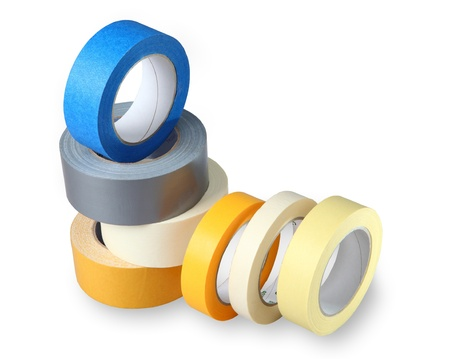 Seven coils colored adhesive tape on paper and polymer-based, isolated image on a white background, horizontal arrangement with painted shade.