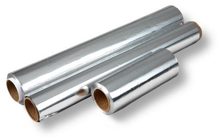 three different roll of aluminum foil for food storage and cooking, isolated image on a white background  Foil rolls of different size  length and thickness  No body  photo