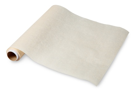 Baking paper, parchment food, is used for cooking and food storage. Thin paper made from pulp mill greasy. No body. The isolated image on a white background. photo