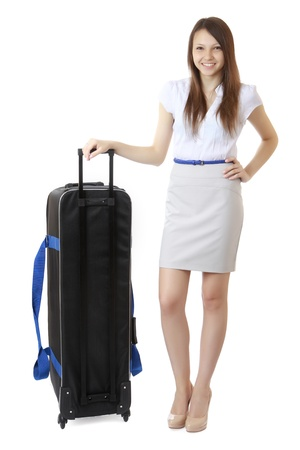Teen girl with a big black travel bag on wheels photo