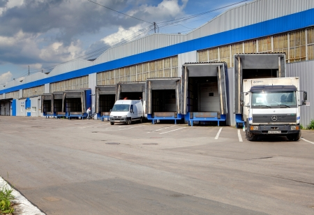 safekeeping: ST-PETERSBURG, RUSSIA - JUNE 13: Row of loading docks warehouse, June 13, 2013. Trucks loaded and unloaded in the warehouse. Editorial