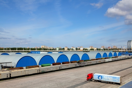 safekeeping: ST-PETERSBURG, RUSSIA - JUNE 13  Blue hangars at the warehouse complex, several buildings in a single line, June 13, 2013  Editorial