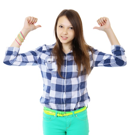 underhand: Young teen girl in a plaid shirt points a two finger behind her back