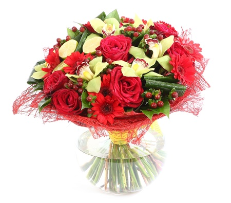 Flower arrangement in glass, transparent vase: red roses, orchids, red gerbera daisies. Isolated on white background. Floristic composition, design a bouquet, floral arrangement.  photo