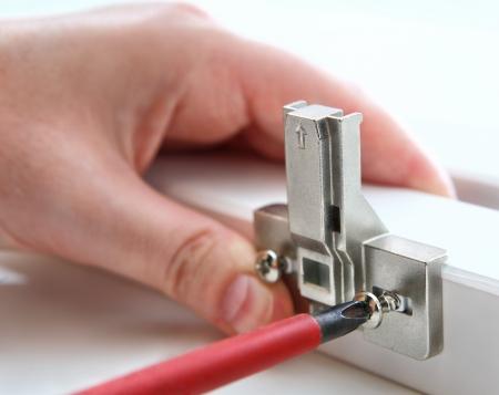 Fixing door furniture hinges  Fixing furniture hinges, using, a screwdriver