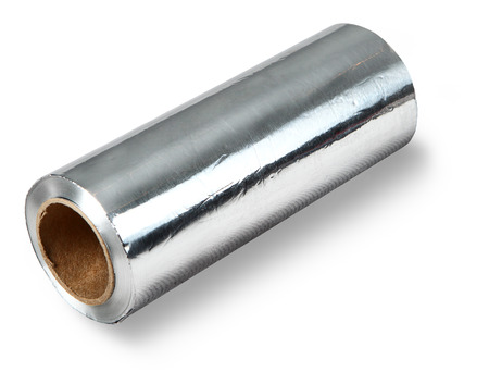 A thick roll of aluminum foil food, baking, and storage of food    Aluminium foil used in cooking  Household aluminium foil for food packaging  The isolated image on a white background  photo
