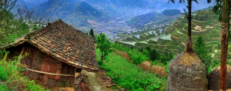 cultivated land: Leishan County. Guizhou, China. Xijiang Miao ethnic minority village. Spring in the mountains of China, the agricultural landscape, rural life. Rice terraces, cultivated land, rice fields. Stock Photo