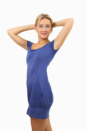 armpits: Caucasian woman, 34 years old, blonde, slim, in short, a fitting close, blue dress, held up her hands up and keep them behind the head, vertical image, isolated on white background