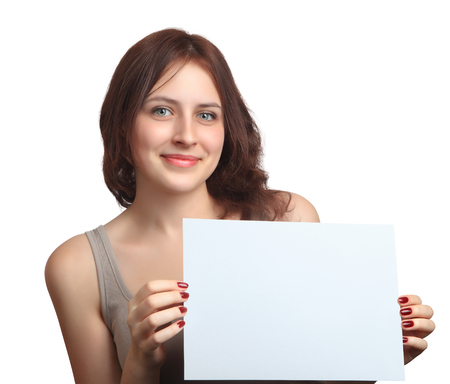 Beautiful, smiling, Caucasian girl 18 years old, with dark red hair down to his shoulders, shows holding blank sign board, closeup portrait, one person, isolated on white background. photo