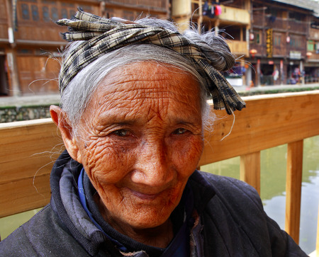 decrepitude: Zhaoxing Dong Village, Liping County, Guizhou Province, China - April 8, 2010: Aged asian woman peasant farmer from rural of China, portrait close up, Zhaoxing Dong Village, Liping County, Guizhou Province, China - April 8, 2010. Editorial