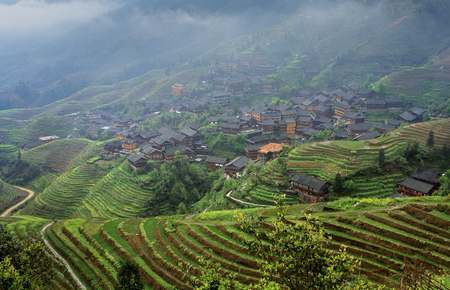 Pingan Village, Guangxi Province, China - April 5, 2010: Mountain village Ping An, spring landscape, rice terraces in the fog, rural nature of China, cultivated farmland, April 5, 2010.