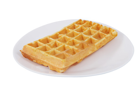 no body: On a white plate is a Belgian waffle, Isolated image on a white background, no body. Stock Photo