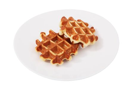 no body: On a white plate is a two Belgian waffles, Isolated image on a white , no body. Soft waffles