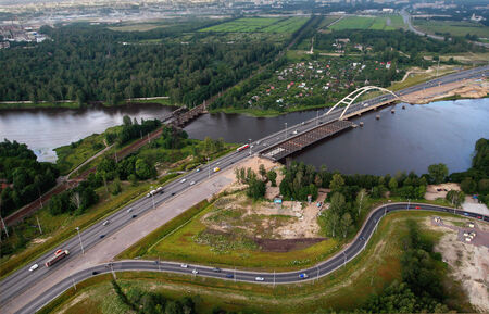 Saint Petersburg, Russia - July 19, 2007: Ring Road crosses the river Big Ohta, it is near the railway station of Rzhevka, top view, aerial photography. Road bridge over the river Big Ohta, construction of the second part. Editorial Use.