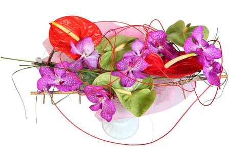 incarnadine: Green and red anthurium in a flower arrangement with violet orchids, bouquet of flowers in plastic vase, floral composition, isolated image on white background