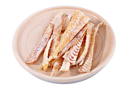 Slices of stockfish on wooden plate  Dried fish fillet, cut into strips  Sliced fish flounder, salted fish beer, beer set on a plate  Isolated image on white background, work path saved  Stock Photo