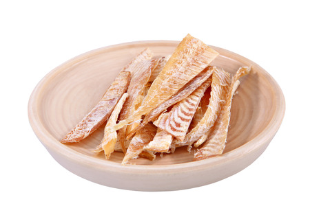 stockfish: Dried fish fillet, cut into slices, and laid out on a wooden plate  Stockfish cut into strips  Flounder fillets salt on plate, set beer  Isolated image on white background, work path saved